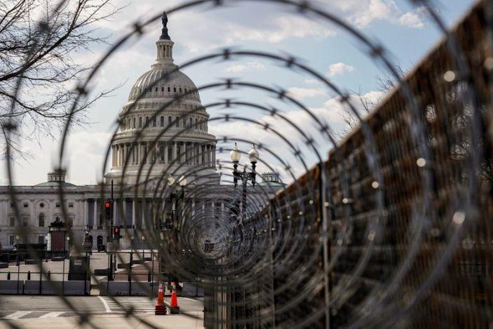 FILE PHOTO: The U.S. Capitol is seen through razor wire in Washington