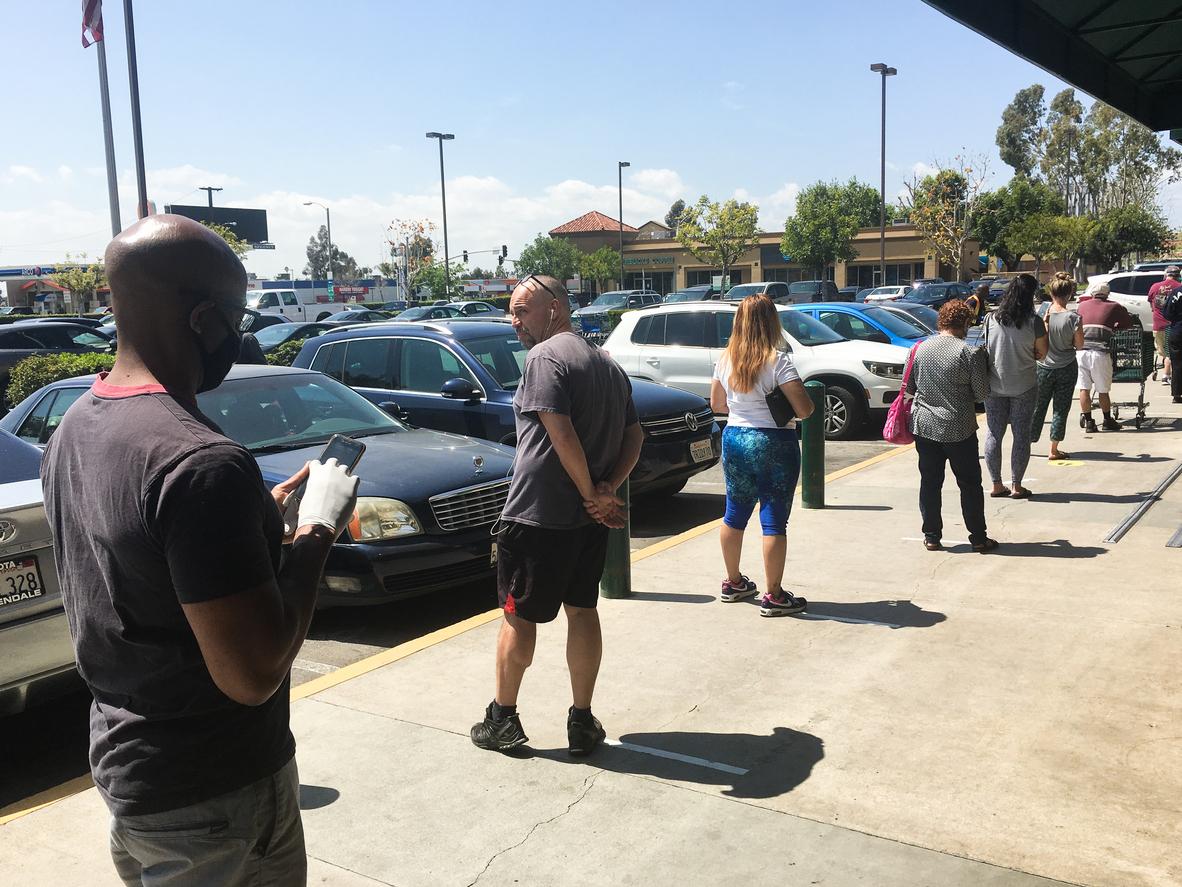 Customer Lines Outside Whole Foods During Covid Corona Virus Epidemic