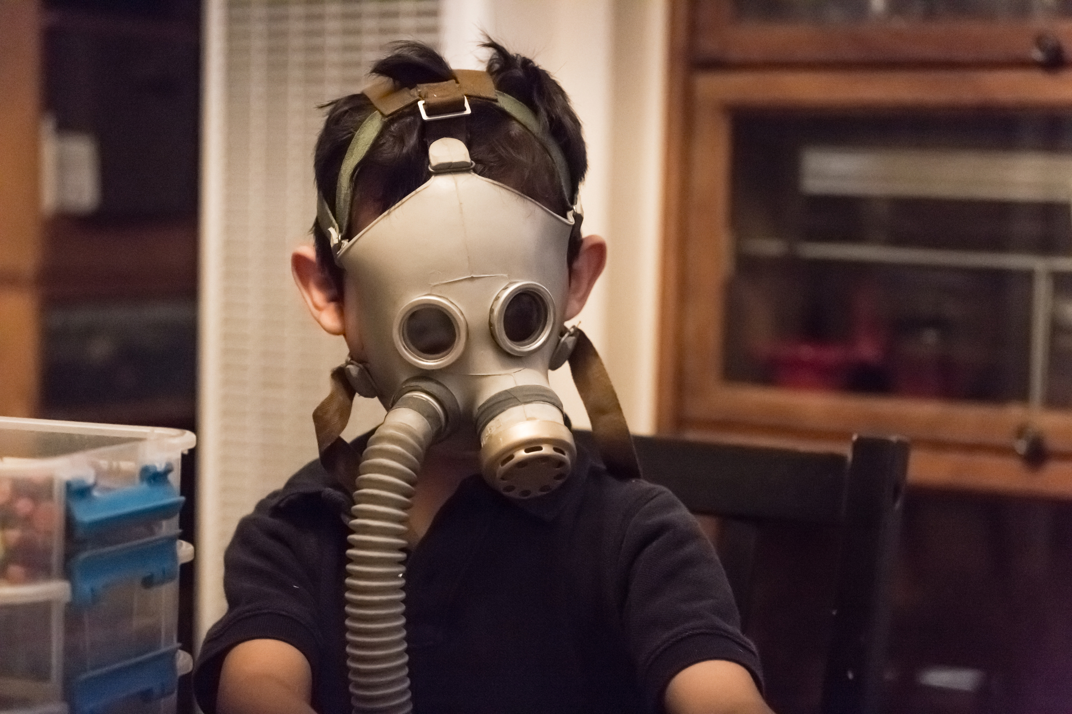 Child wearing nuclear gas mask during nuclear fallout