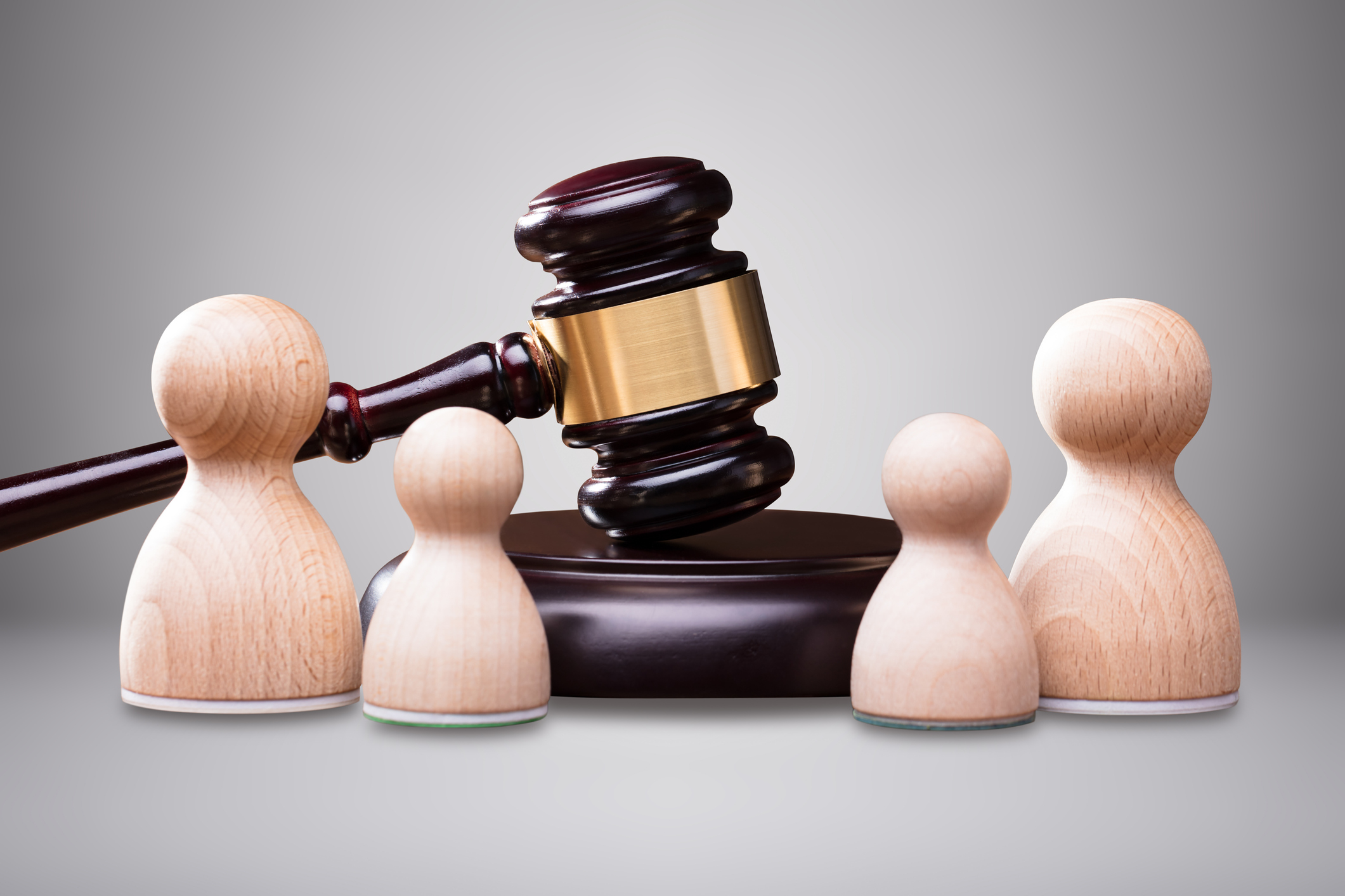 Wooden Pawns In Front Of Gavel And Mallet